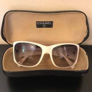 Chanel White w/pearl embellished brand logo.